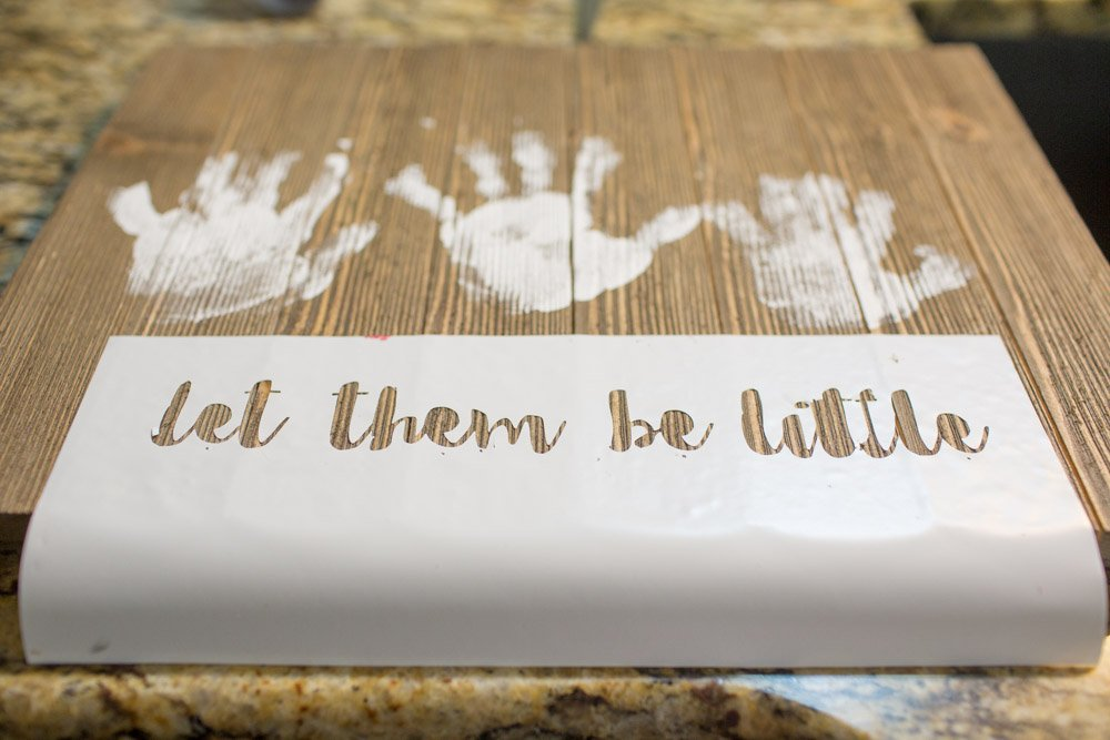kids handprint project on wood