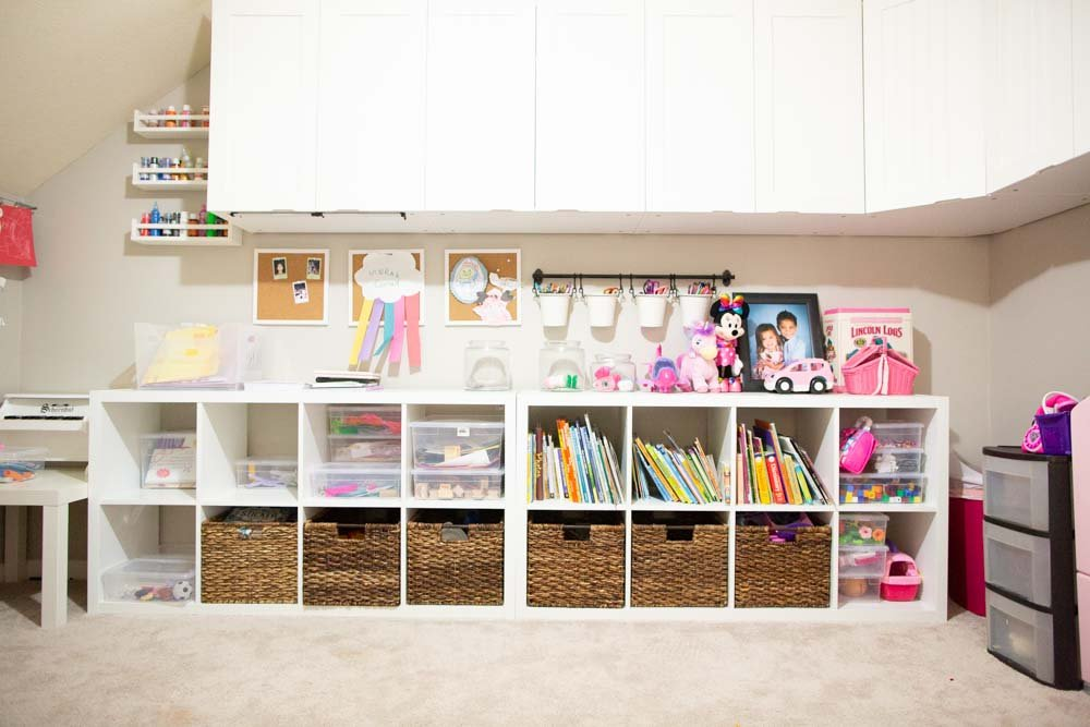 playroom organization with labels on storage and bisn
