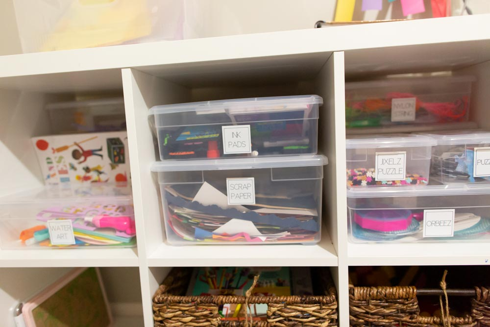 playroom organization with bins labels and labeler