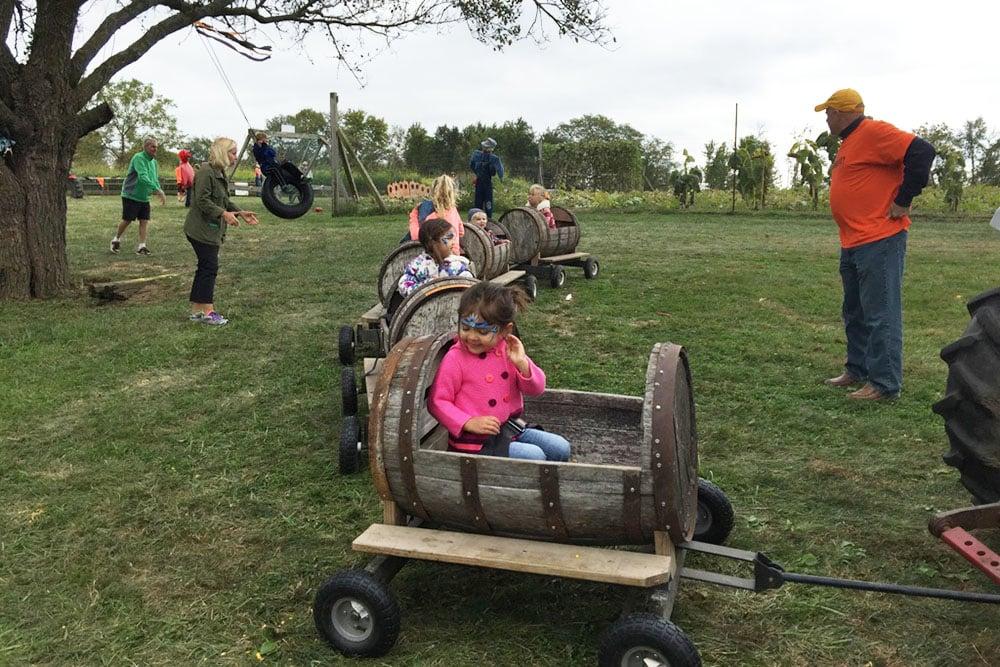 kids in barrel car