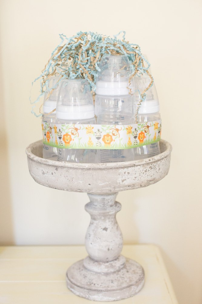 Baby shower decor using baby bottle cake idea for Baby bottles decoration