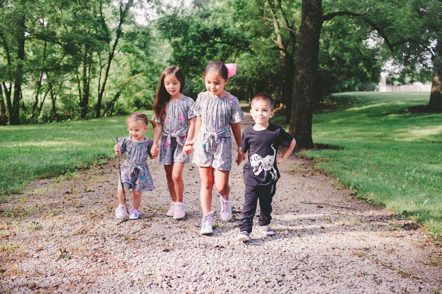 family of four kids - sisters matching unicorn outfits