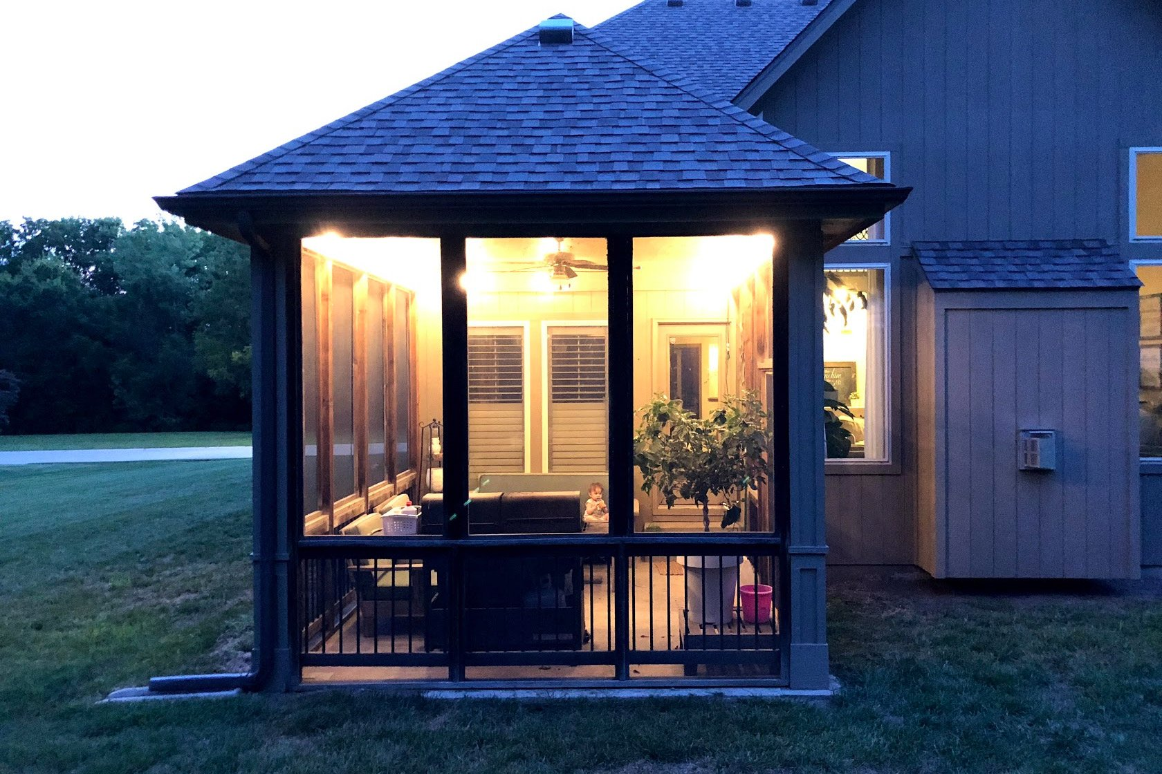 How to Hang String Lights on Covered Patio or Deck featured by top US DIY blogger, Sengerson: outdoor seating string lighting