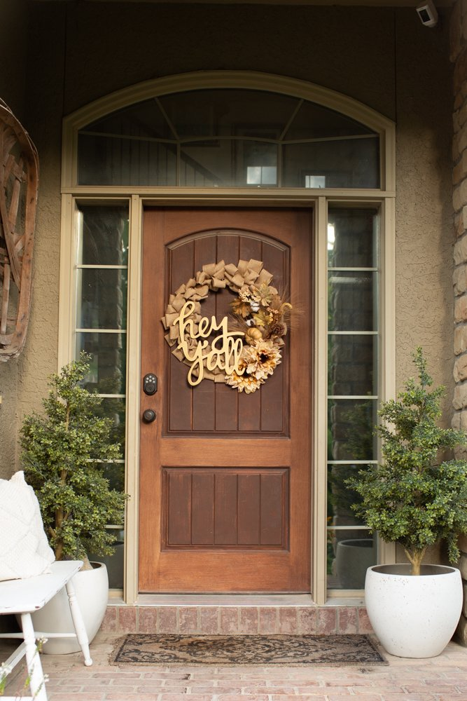 harvest burlap ribbon wreath with quote on front door