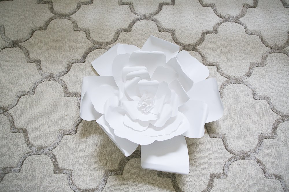 large flower wall art above bed-7 | DIY Large Paper Flowers tutorial featured by top US lifestyle blogger, Sengerson
