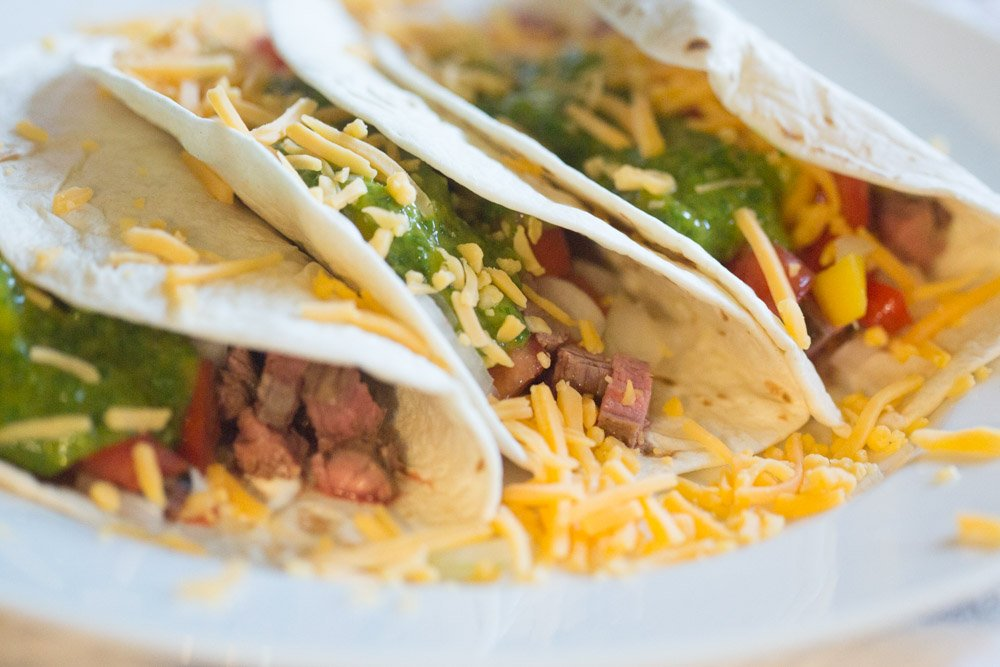 Easy Chimichurri Steak Tacos featured by top US food blogger, Sengerson