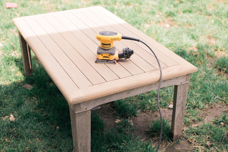 restoring teak furniture, teak patio set sanding with palm sander