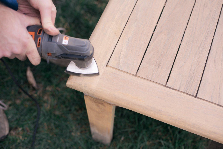 restoring teak furniture, teak patio set using a tool oscilates