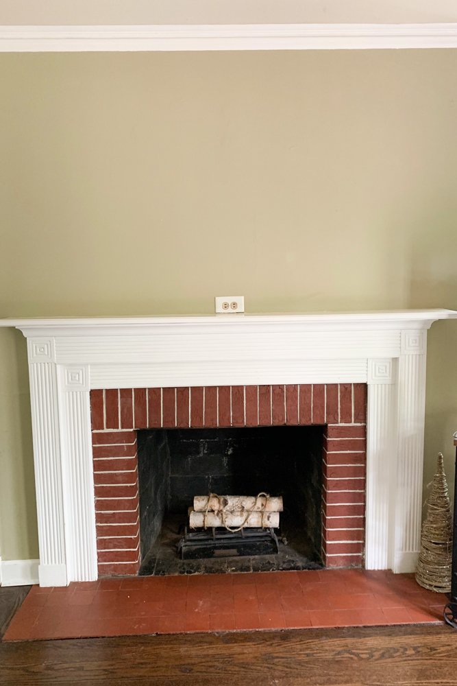 shiplap fireplace with accent wall before