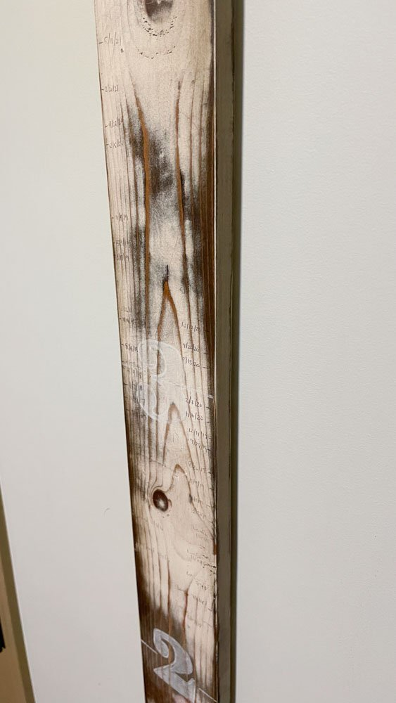 distressed wooden growth chart edge and side view