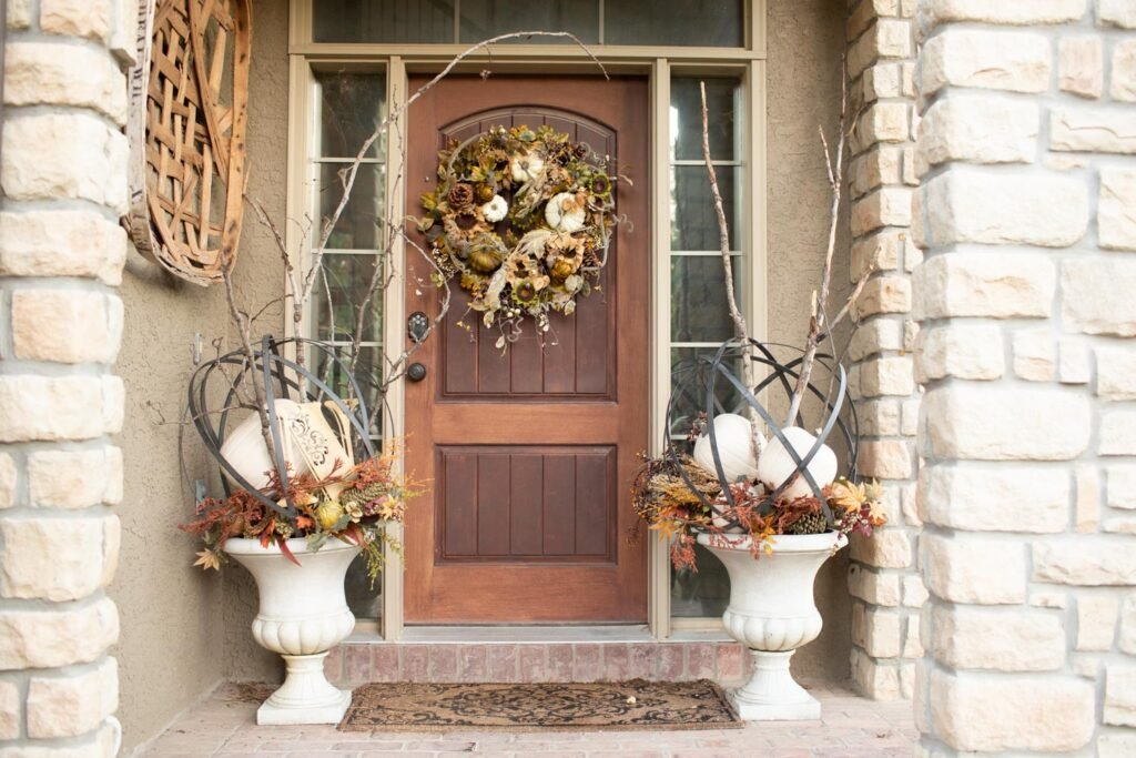 small front porch with urns and branches