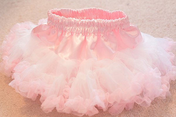 This is a chiffon DIY tutu skirt that is a DIY layered tutu pettiskirt that any girl will love. All you need is a sewing machine. It's super easy to make. This chiffon tutu dress is any little girl's dream!